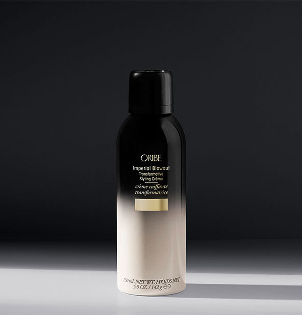 White-to-black can of Oribe Imperial Blowout Transformative Styling Crème on gray background