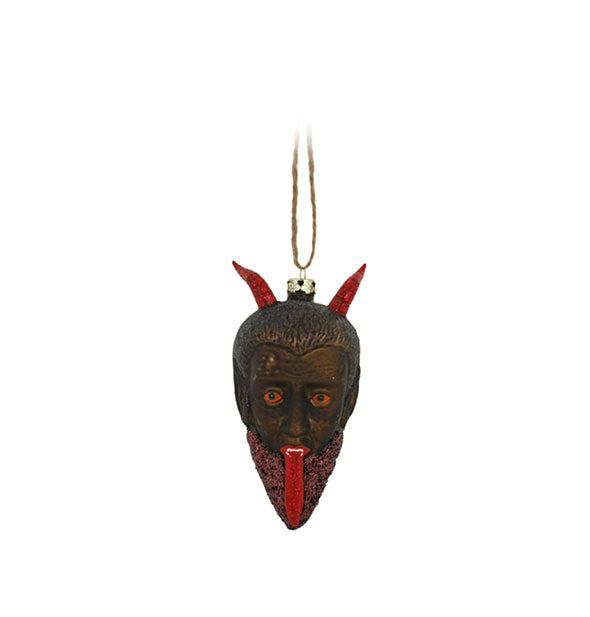Devil tree ornament with long tongue and horns