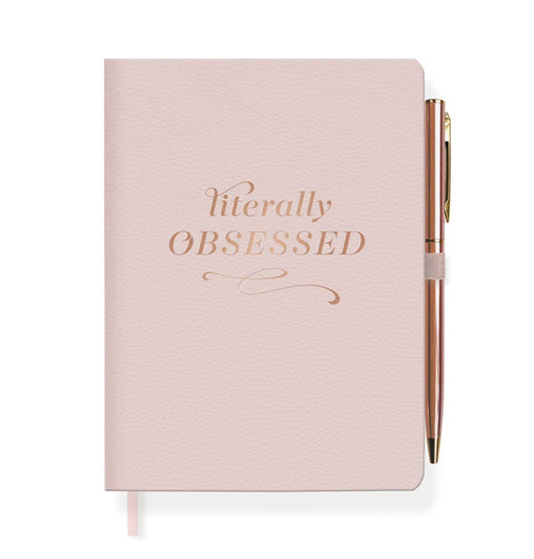 Blush pink journal with rose gold imprint, rose gold pen, and ribbon place marker shown