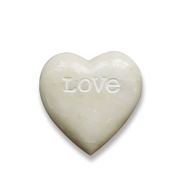 "White carved soapstone heart engraved with the word, ""Love"""