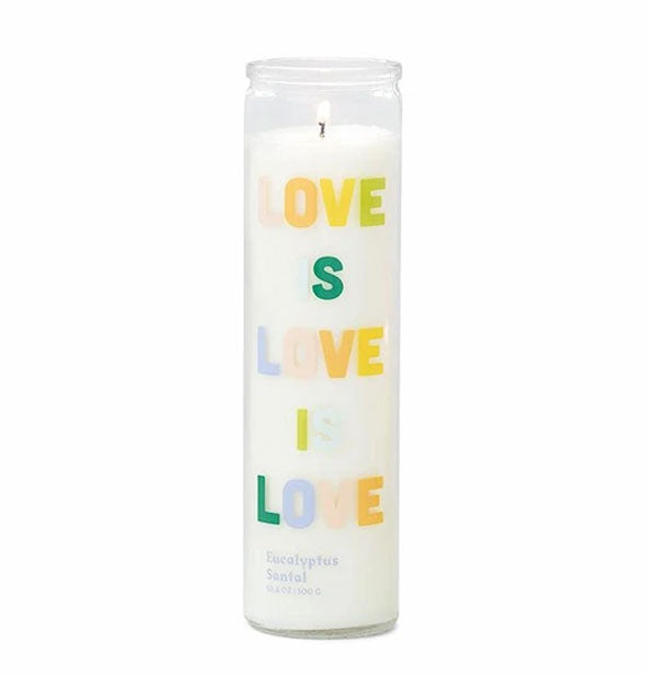 "Tall prayer candle with white Eucalyptus Santal scented wax and glass printed with the phrase, ""Love Is Love Is Love"" in colorful lettering."