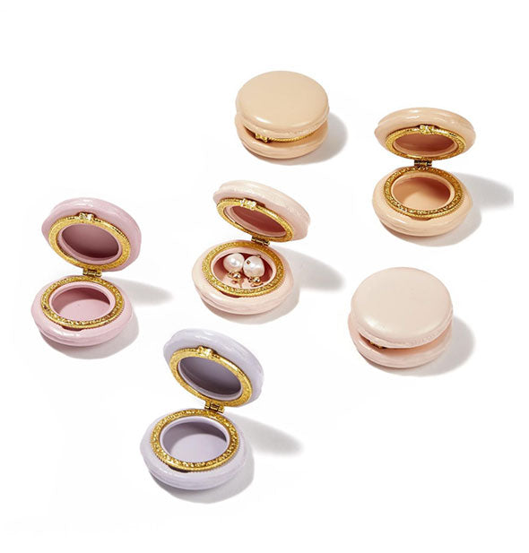 A grouping of round pastel jewelry boxes with gold rims