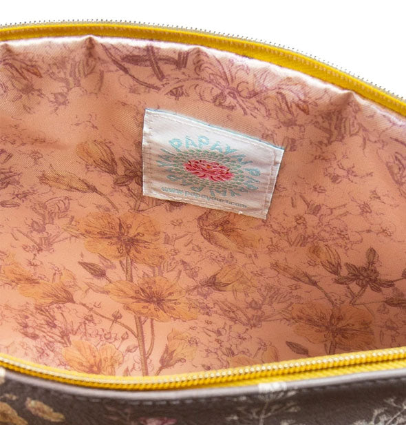 Pouch interior with pink floral lining and Papaya label