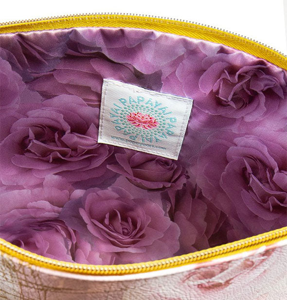 Pouch interior with vibrant purple rose print lining and Papaya label shown