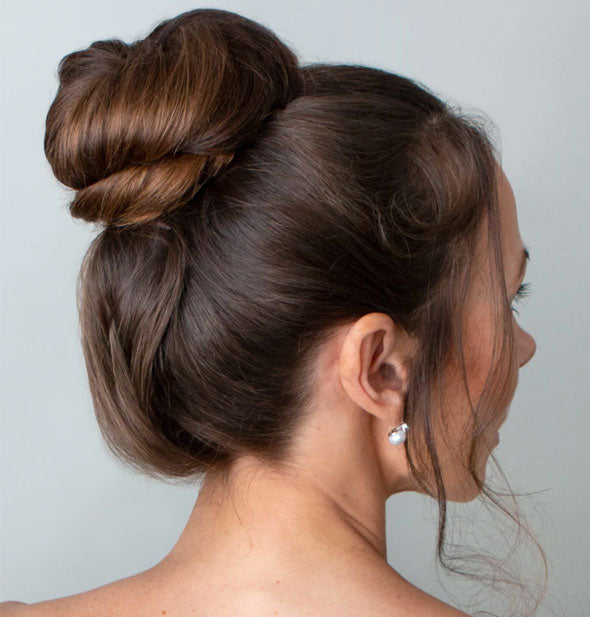 Model wearing high bun hairstyle