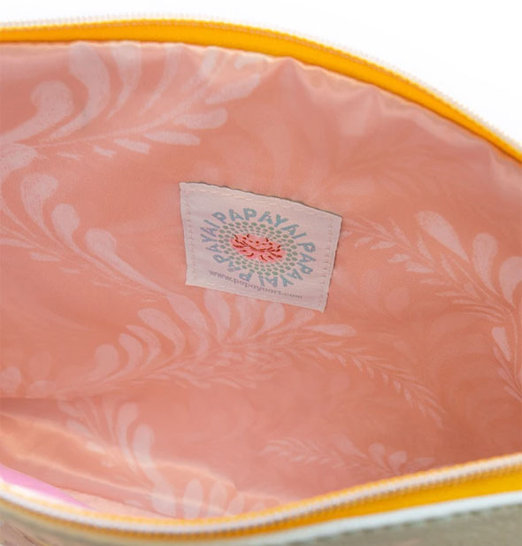 Pouch interior with pink patterned lining and Papaya label