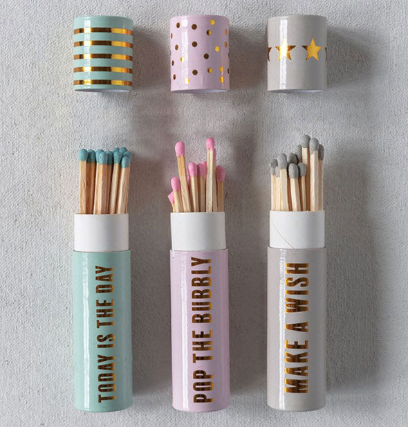 Grouping of three matchbox tubes with gold foil printing and details
