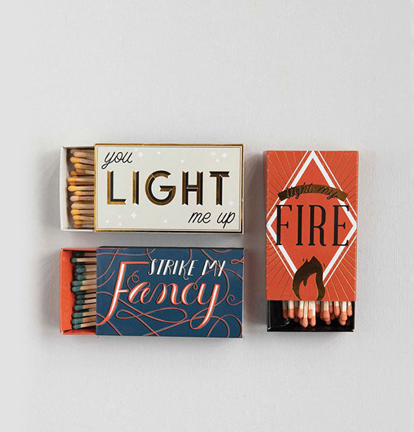 Grouping of three artistic matchboxes