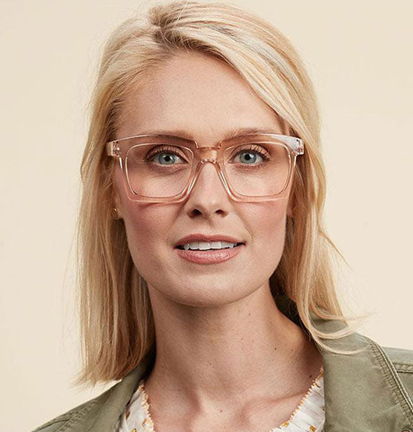 A model wears a Tan pair of Peepers Standing Ovation Readers.
