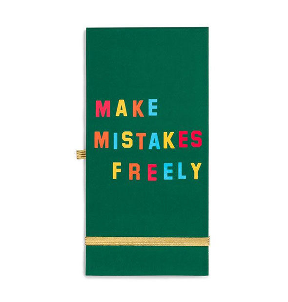 Green notebook cover with colorful lettering and gold elastic bands