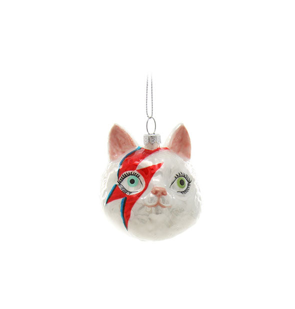 White cat head ornament with David Bowie lightning bolt face paint