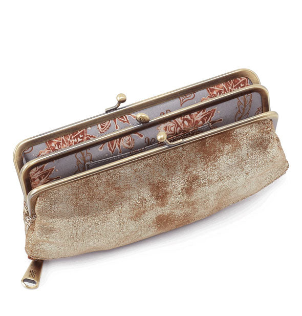 Open metallic leather wallet with brushed nickel hardware and floral lining