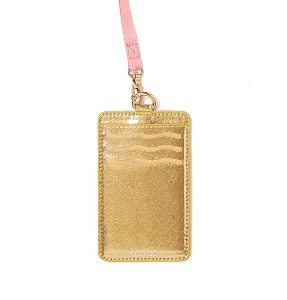 Metallic gold card case with pink lanyard attached