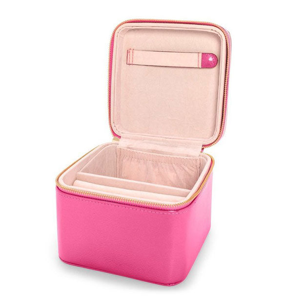 Open pink box with gold zipper and light tan interior