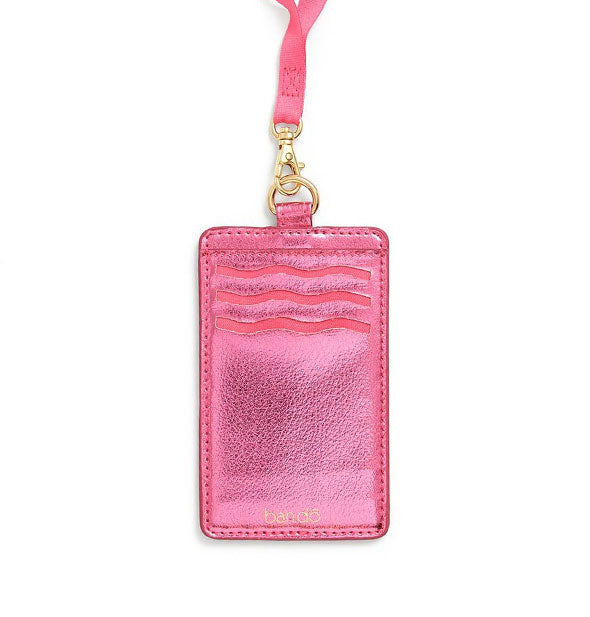 Metallic pink card case with gold hardware and pink lanyard attached
