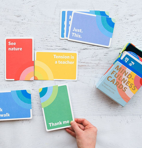 Spread of Mindfulness Cards on a painted wooden surface