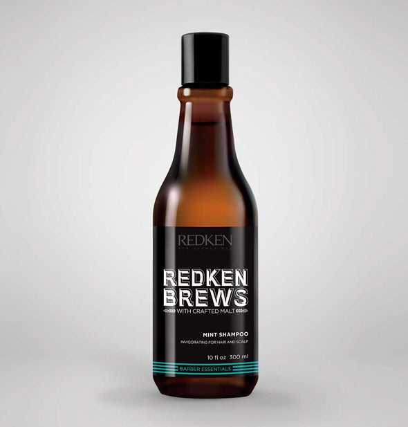 A bottle of Redken Brews Mint Shampoo with Crafted Malt 10 fl OZ