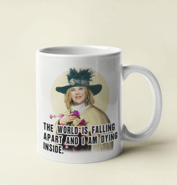 "White coffee mug with image of Schitt's Creek character Moira Rose says, ""The world is falling apart and I am dying inside."""