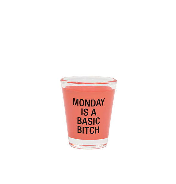 Monday Is a Basic Bitch shot glass with coral color band and black lettering