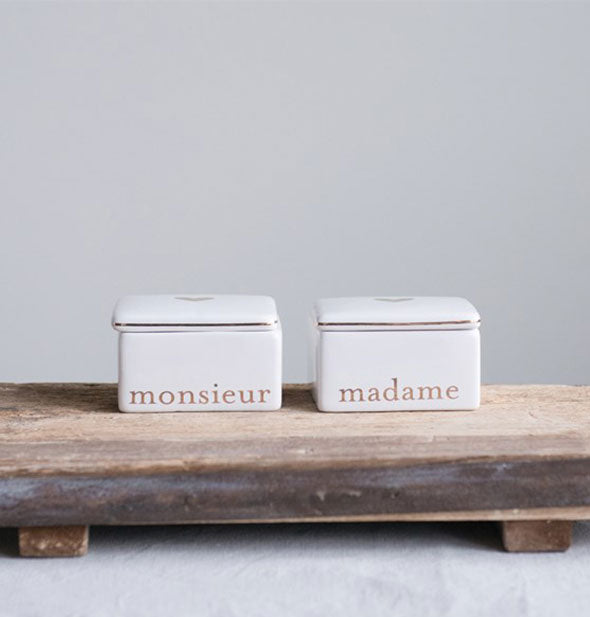 Monsieur and Madame boxes on a wooden surface