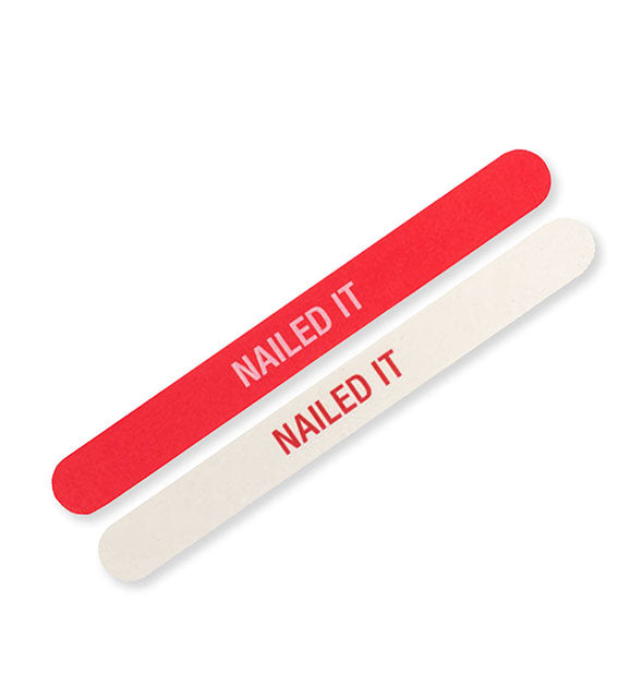 Red Nailed It nail file with white lettering and white Nailed It nail file with red lettering