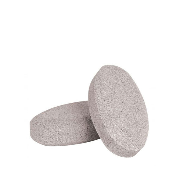 Two oval pumice stones, one leaning against the other