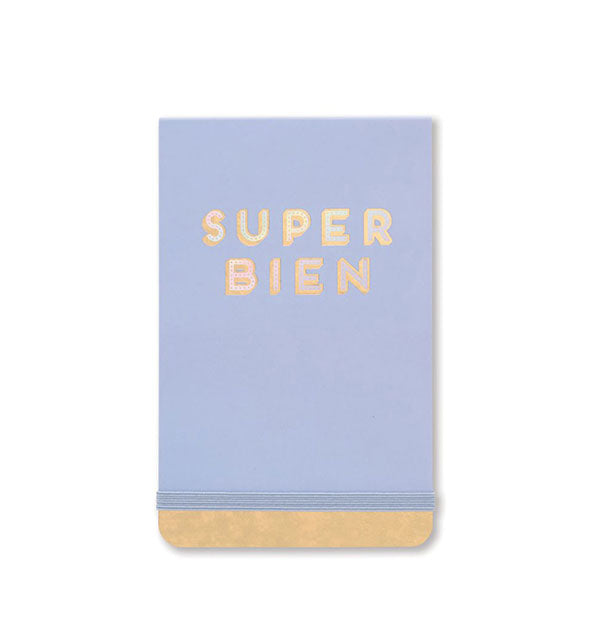 "Periwinkle notepad cover with iridescent gold accent and ""Super Bien"" wording and elastic band closure shown."