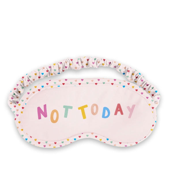 "Blush pink sleep mask with colorful ""Not Today"" lettering and small heart print on border and ruched elastic band"