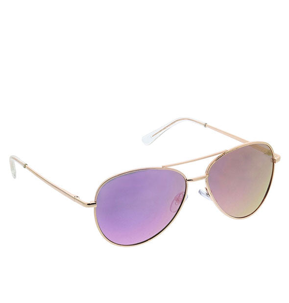 Angled view of Peepers Heat Wave Polarized Sunglasses in Pink.