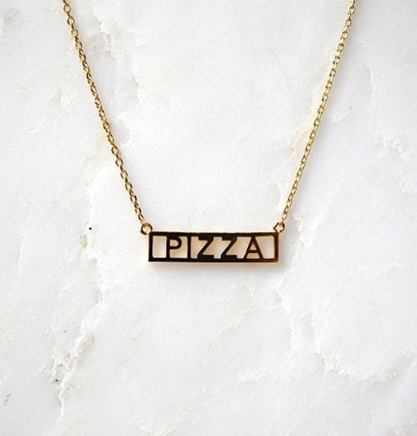 Gold PIZZA bar necklace on marble background