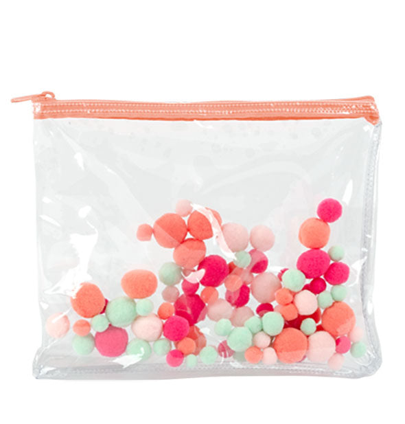 Clear vinyl pouch with coral zipper and multicolored plush pom poms embedded in the plastic