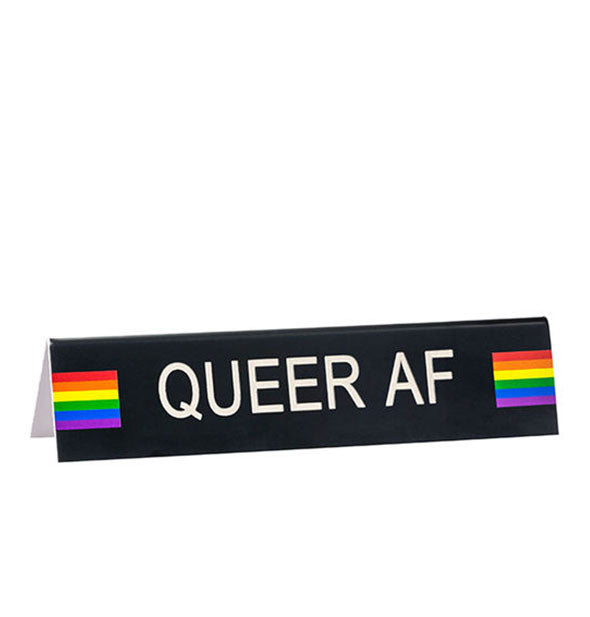 Black rectangular Queer AF desk sign with rainbow detail