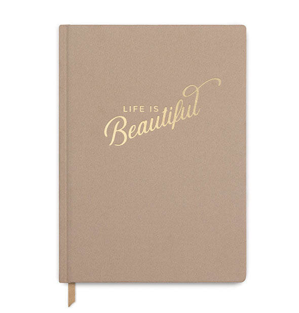 "Light brown cloth cover journal stamped with the phrase, ""Life is Beautiful"" in metallic gold foil."