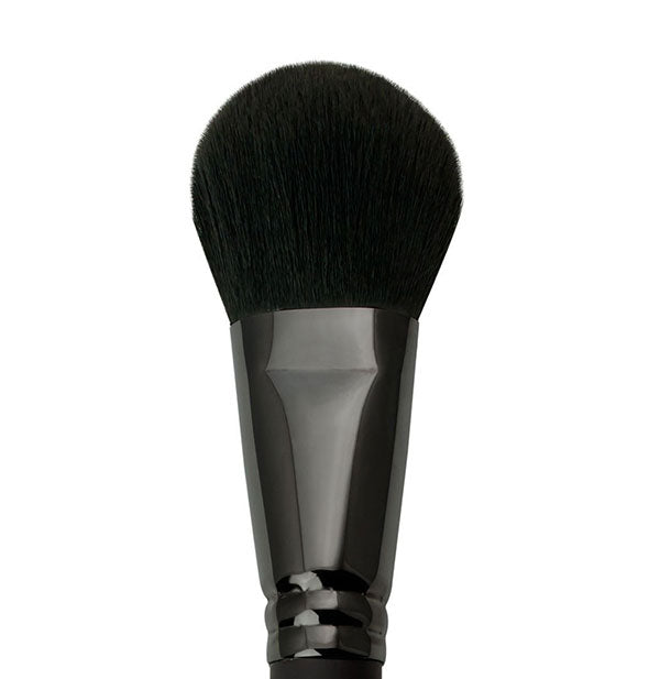 A close-up view of The Revolution Large Powder Brush by Royal Brush