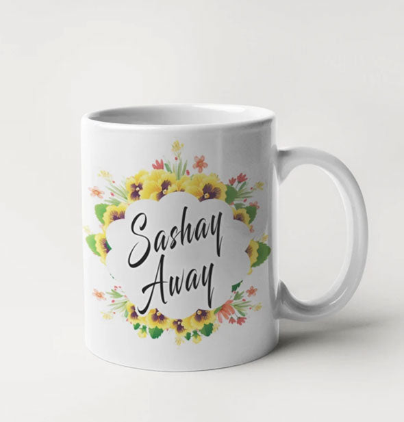 "White coffee mug with floral design says, ""Sashay Away"" in black script"