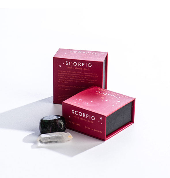Two fuchsia Scorpio Mini Stone Packs with crystals displayed in front.