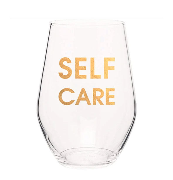 "Clear stemless wine glass imprinted with ""Self Care"" in metallic gold."