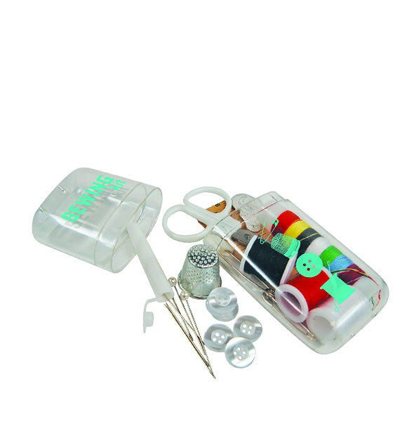 Sewing Kit case open with contents—including pins, thimble, buttons, thread, and scissors—partially shown