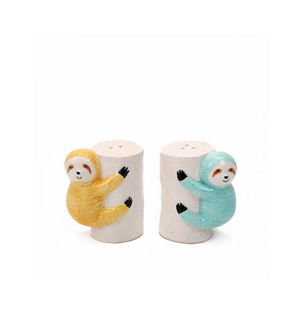Ceramic sloths clinging to tree trunks salt and pepper shakers