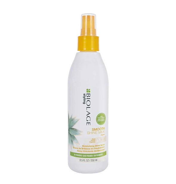White 8.5-ounce bottle of Biolage Styling Smooth Shine Milk Moisturizing Shine Spray with yellow spray nozzle and green design accents.
