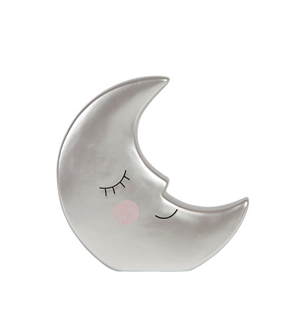 Metallic silver crescent moon-shaped money bank with smiling facial features