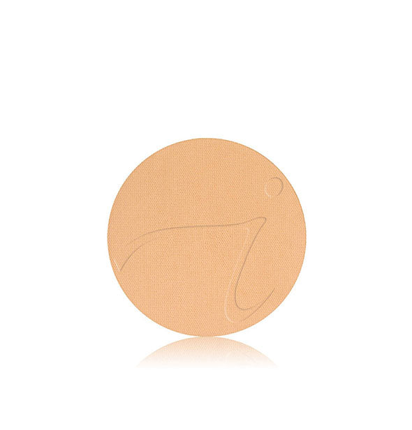 A disc of Jane Iredale PurePressed Base Mineral Foundation Powder Refill in the shade Sweet Honey.