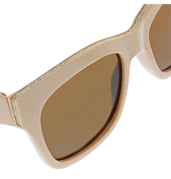 Detail view of sparkle embellishment on the taupe Peepers Shine On Sunglasses.