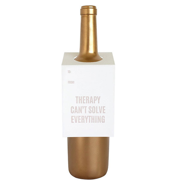 "A white tag labeled ""Therapy Can't Solve Everything"" fits over the neck of a gold wine bottle."