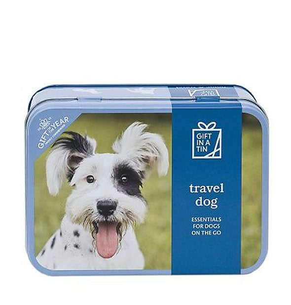 "A rectangular tin with rounded corners features a picture of a terrier and print that reads, ""Travel Dog: Essentials for Dogs on the Go."""