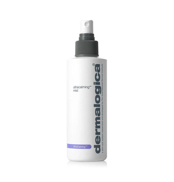 White bottle of Dermalogica UltraCalming Mist with purple accent stripe and grey and white spray nozzle.