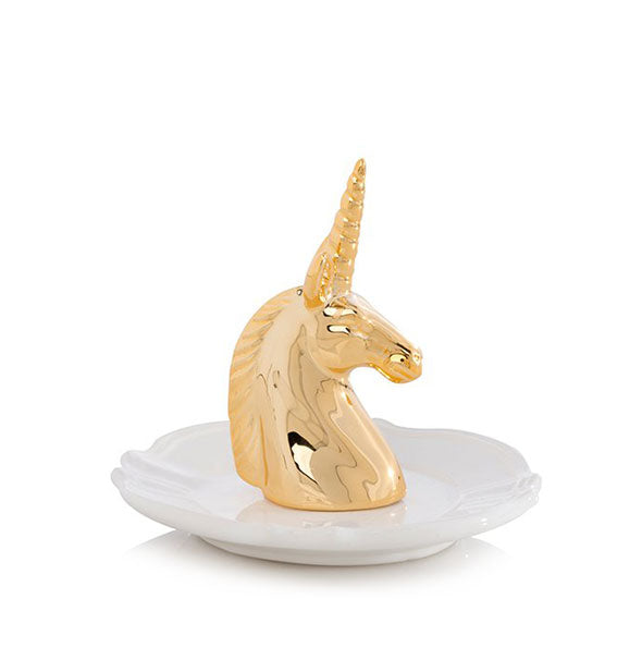 A white jewelry and accessory dish with gold unicorn head in the center.