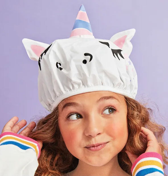 A model wears the unicorn shower cap