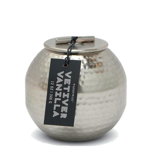 "Rounded, hammered silver metal candle with rustic lid and hangtag that reads, ""Vetiver Vanilla."""