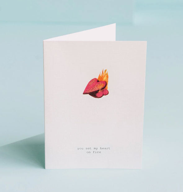 "Greeting card featuring illustration of a heart set ablaze is captioned, ""You set my heart on fire"""